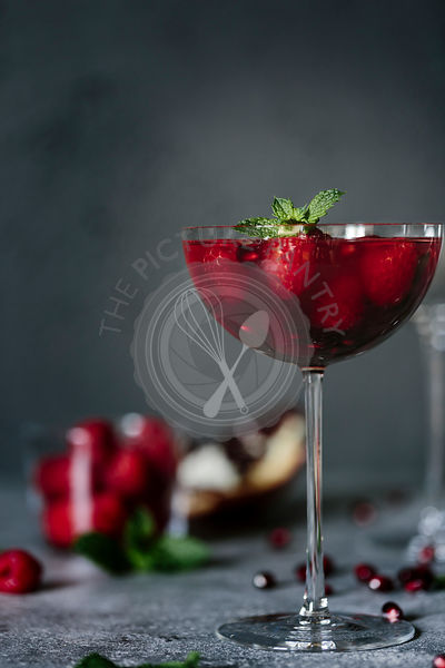 Raspberry and Pomegranate Champagne Cocktail