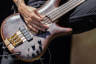 Alex Torres playing bass on tour with Escape the Fate, Aftershock 2014