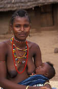 Bedik woman with porcupine coil through her nose with baby, Iwol, Bedik village, Bassari country, Senegal