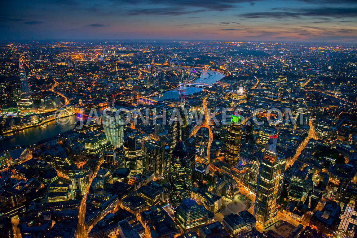Aerial view of the City at night showing Heron Tower and 30 St Mary Axe, London