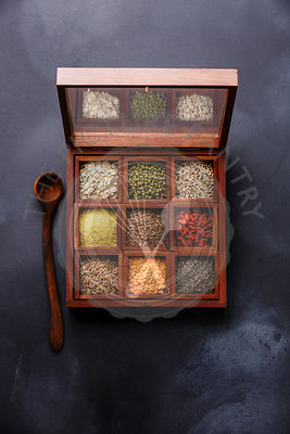 Superfoods and cereals selection in wooden box: oat, mung, quinoa, bulgur, flax seed, goji berry, polba, lentil and chia on d...