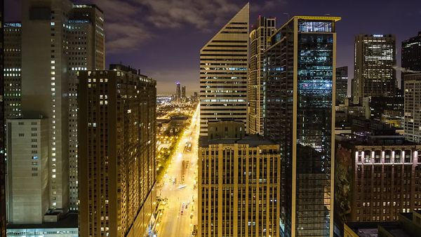 Bird's Eye: Medium Shot - Night to Day - The Progression of Morning Rush Hour on Michigan Avenue, Looking South From Outside ...