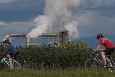 Cyclists pass a sawmill, West Eugene wetlands, Willamette Valley, Oregon