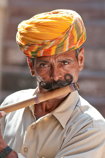 A folk musician plays flute in a village in Jodhpur