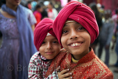 Brothers in red turbans at a Sikh Festival in Paharganj, Delhi, India