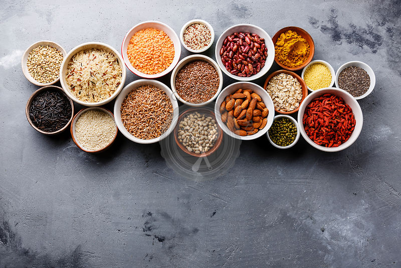 Superfoods and cereals selection in bowls: quinoa, chia, goji berry, mung bean, buckwheat, bean, turmeric, polba, bulgur, len...