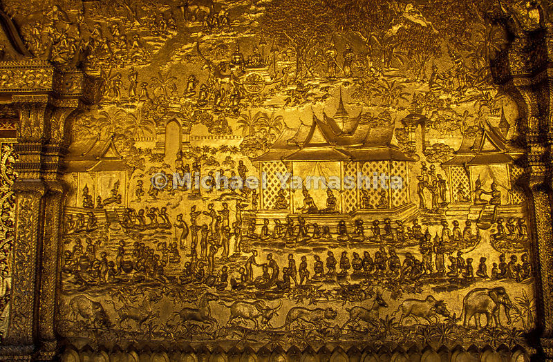 An ornately carved wall in a Buddhist Temple, Laos.
