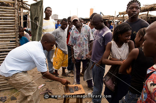 Mozambique, Beira,Tchungamoyo market. Gambling games are common entertainement in the market.
