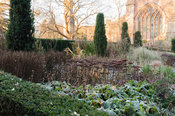 The hot border in the East Garden of the Bishop's Palace garden, where fastigiate Irish yews stand sentinel over a rich mix o...