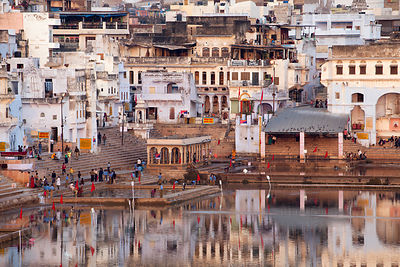 Temples reflecting in Pushkar Lake, Pushkar, Rajasthan, India.