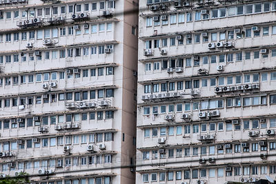 Air conditioners in Mumbai high-rise apartments. In India's largest city residents wither under oppressive heat and humidity....