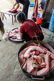 Salting Meat Cut from a Killed Pig