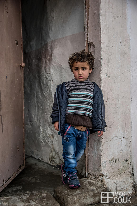 Small Kurdish Boy In A Doorway