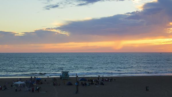 Wide Shot: Panning A Gorgeous Fiery Sunset Over Santa Monica Beach