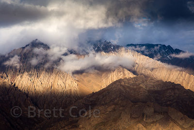 Rugged brown slopes of the Himalayas at sunrise, south of Leh, Ladakh, India