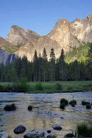 Evening light on the Merced River and the rocky peaks of Yosemite National Park, California.