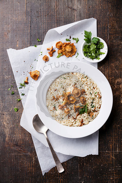 Risotto with chanterelles in white bowl