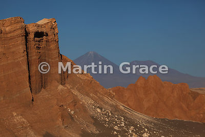View towards Licancabur (the left hand volcano behind) from viewpoint in the Valley of the Moon, Atacama