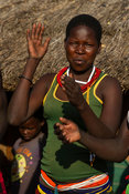 Karamojong woman dancing in the village, northern Uganda