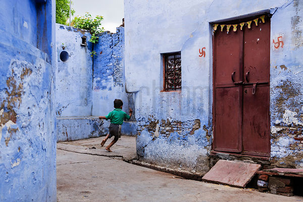 Young Child Running in Alleyway