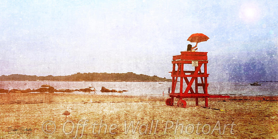 girl with umbrella on lifeguard stand