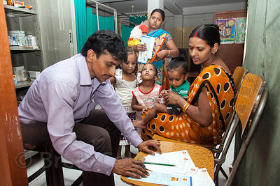 Mothers and babies recieve medical care, counseling, and supplemental meals at the Swastha Kendra clinic operated by the NGO ...