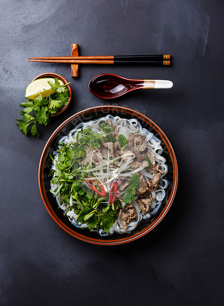 Pho Bo vietnamese Soup with beef on dark background