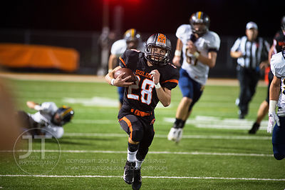 Solon's Hunter Kula (28) breaks a run against Iowa City Regina during the first half of play in Solon on Friday, September 1,...