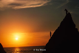 A boy on a cliff at Sunset in Acapulco, Mexico