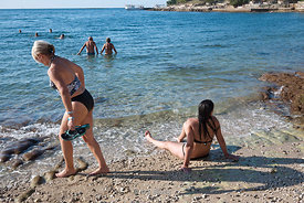 People hanging out on the beach in Poreč, Croatia.