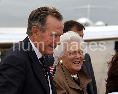 Former US President George Bush and First Lady Barbara Bush are greeted upon their arrival on Andrews Air Force Base, Marylan...