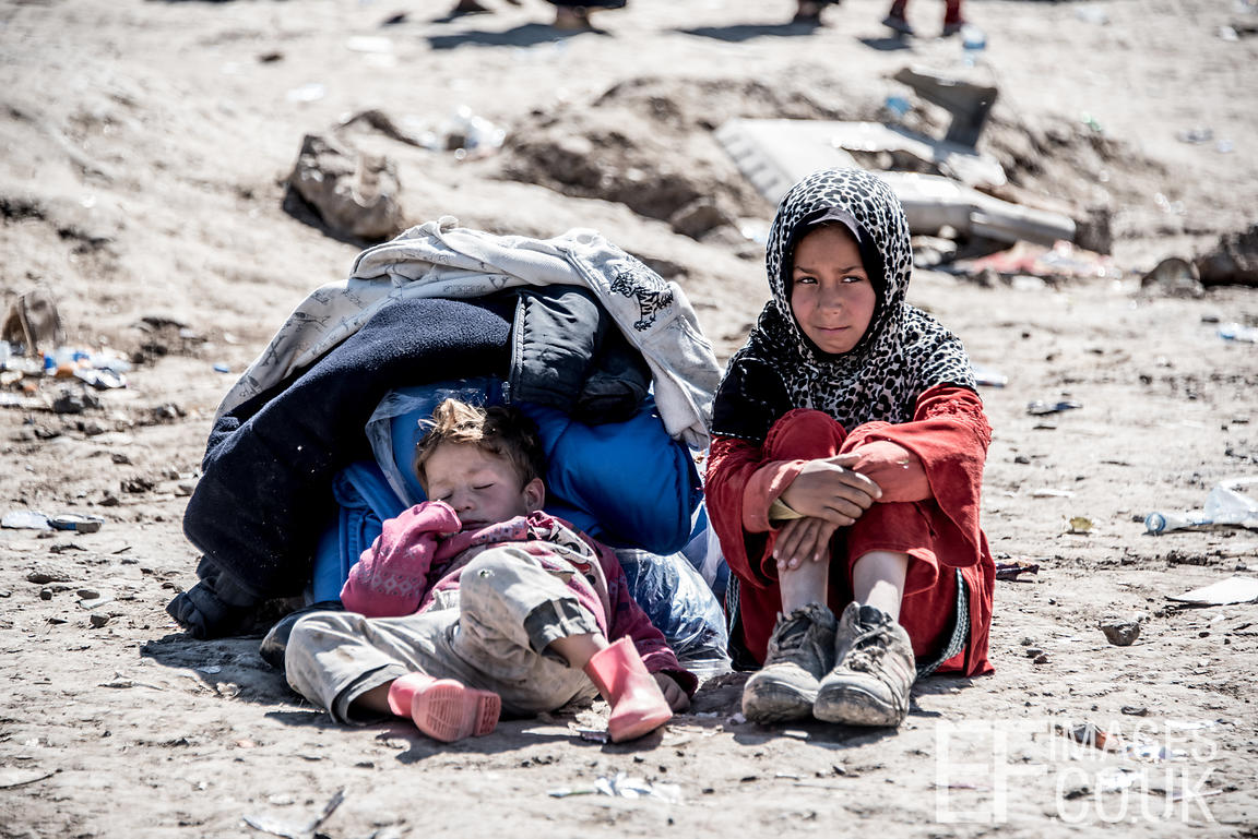 A Little Girl Sits Outside Hamam al Alil IDP Camp Having Escaped From Mosul That Morning.
