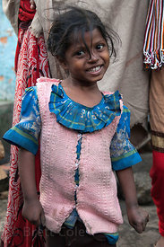 Portrait of a plucky girl in the Fakir Bagan neigborhood of Howrah, India, in an area served by the NGO Calcutta Kids (calcut...
