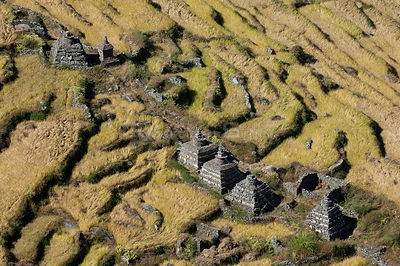 Aerial view of Chortens / Stupa (Buddhist sites) in millet fields, Tamang heritage trail, Gadlang, Langtang region, Nepal, No...