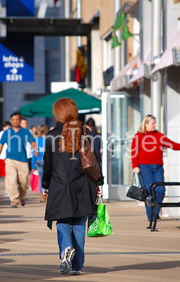 Lone woman walking outside at shopping center