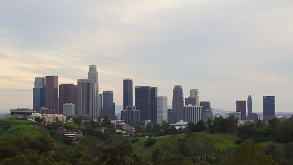 Wide Shot: L.A. Skyline & Green Hills Under A Subtle Cloud Deck - Natural Night To Day Transition