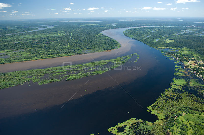 Aerial view of the meeting of the brown waters of River Mamoré and the black waters of River Guaporé / Itenez during the grea...