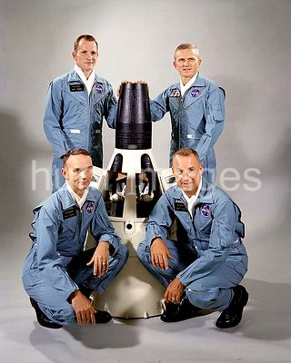 (September 1965) --- Portrait of the Gemini-7 prime and backup crew members around a model of the Gemini-7 spacecraft. From t...