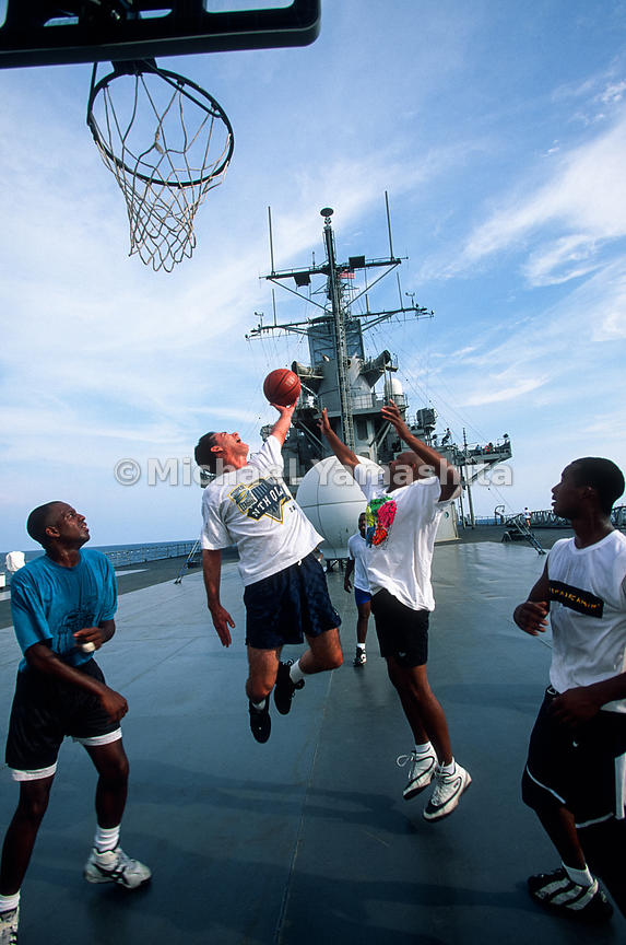 U.S.S. Blue Ridge Flagship of the 7th Fleet. Admiral Natter playing basketball with fellow crew members..Penang, Malaysia