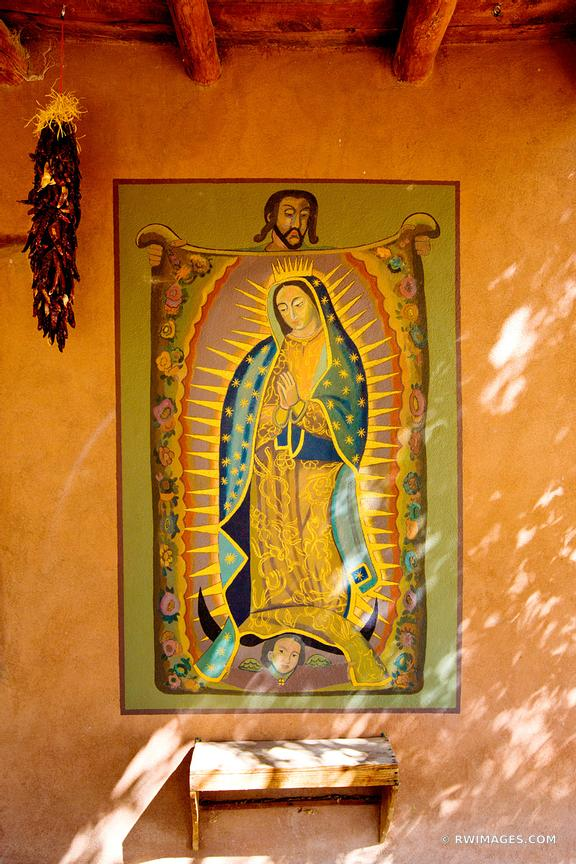 CATHOLIC WALL PAINTING AND RED CHILI PEPPERS RISTRAS TURQUOISE TRAIL NEW MEXICO