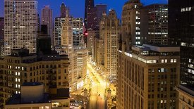 Bird's Eye: Medium Shot - Night to Day - The Progression of Sun Painting Morning Rush Hour on Michigan Avenue, Looking North,...