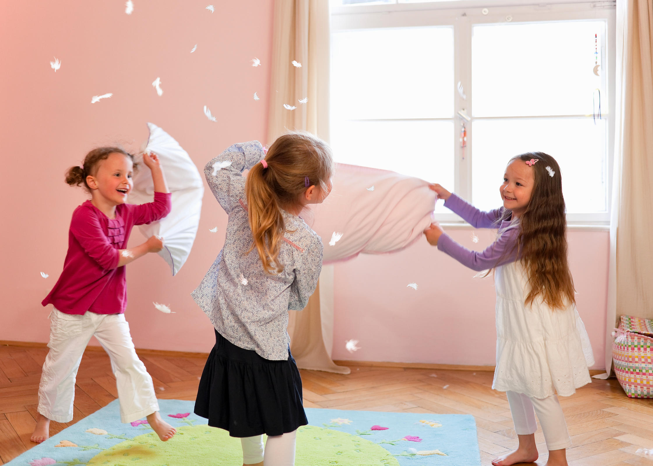 Girls having a pillow fight