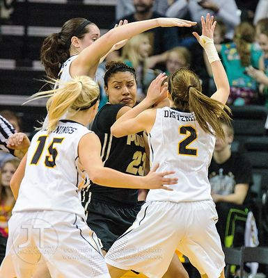 Purdue's Liza Clemons (23) is surrounded by Iowa defenders during the second half of play at Carver-Hawkeye Arena in Iowa Cit...