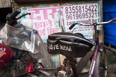 "The words ""I Love India"" on the back of a bicycle seat in Sion, Mumbai, India."