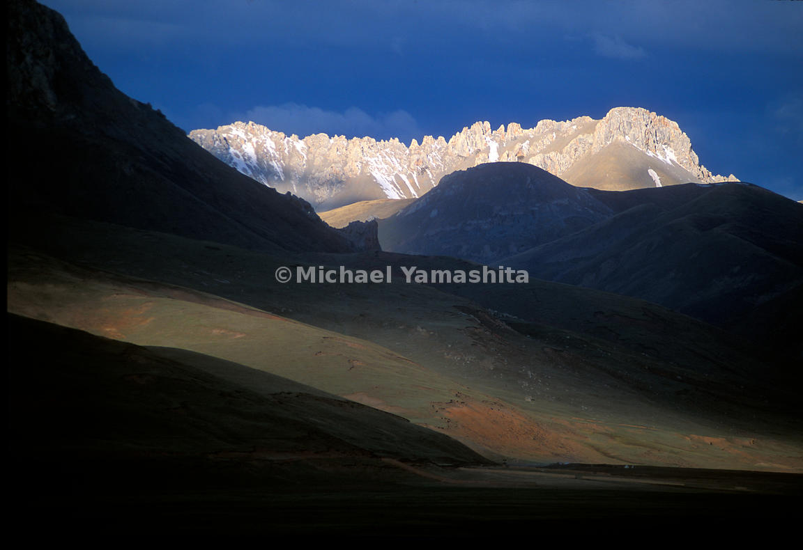 Dawn in Qinghai reveals the Tibetan Plateau's dramatically beautiful skyline. Beyond these mountains of the towering Tibetan...