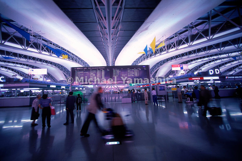 Inside a bustling terminal at the ultra-modern Osaka International Airport.