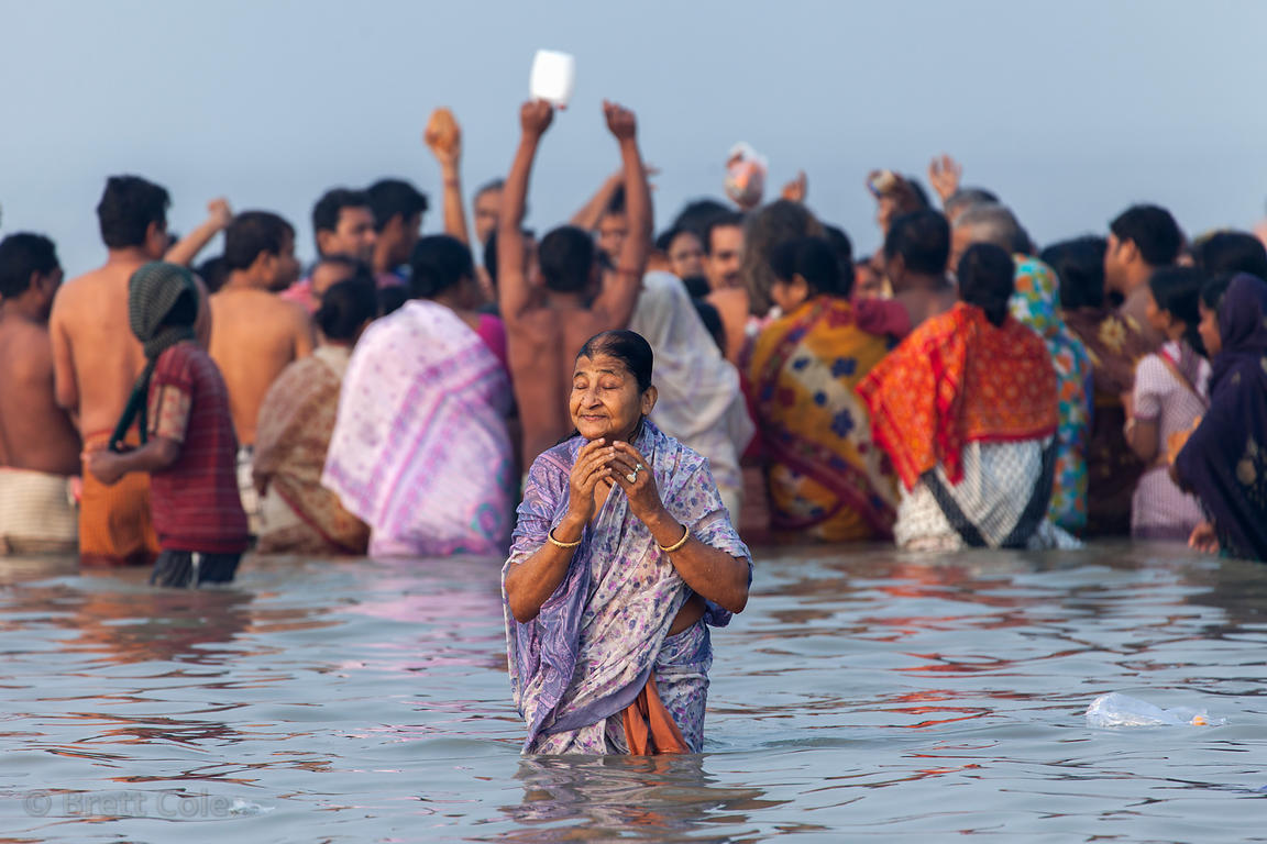 A woman bathes and prays in the Bay of Bengal at the Gangasagar Mela (festival), a pilgrimage to Sagar Island in India, where...