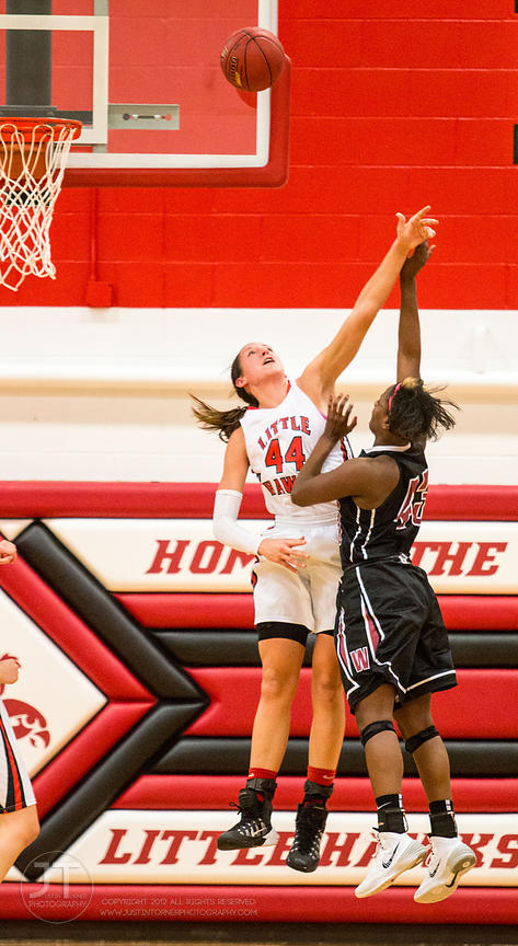 Iowa City High's Haley Lorenzen (44) goes up to block a shot versus Waterloo West's Blaire Thomas (43) during the first half ...