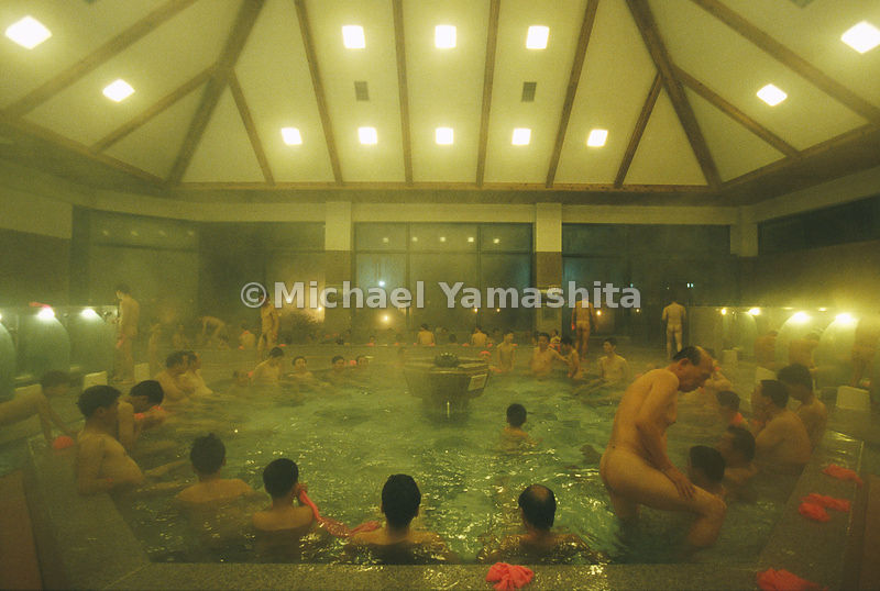 Tourists in a hot spa bathhouse, North Korea.