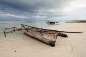 Tanzania, Zanzibar, Pwani Mchangani village on the East Coast. Fishing boat lying on the beach.